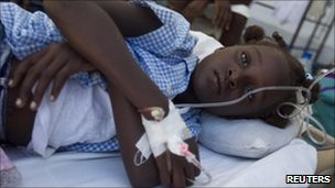 A young girl with cholera lies on a bed at St Nicholas Hospital in St Marc, 25 October 2010.
