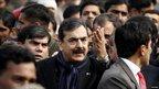 Prime Minister Yusuf Raza Gilani gesturing