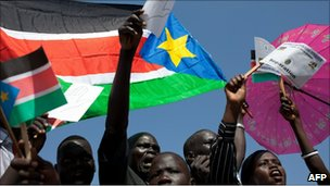 Sudanese supporters of secession wave regional flags and pro-separation placards
