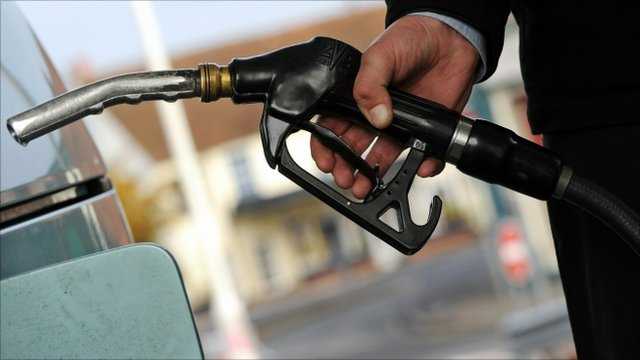 Customer pulls the nozzle of a petrol pump