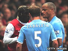 Sagna (left) squares up to Zabaleta