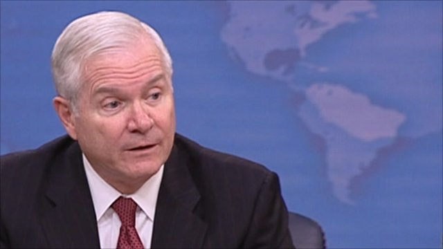 Robert Gates addressing journalists