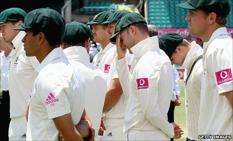 Michael Clarke (rubbing head) and the Australia team after their Ashes series defeat