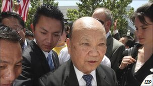 May 11, 2009 file photo, former Laotian General Vang Pao, centre, is escorted by supporters to the federal courthouse, in Sacramento, California