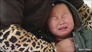 A child who was diagnosed with having excessive lead in his blood cries as he receives medical treatment at a hospital in Hefei, Anhui province