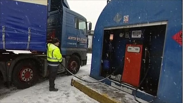 Lorry driver filling up petrol