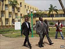 Alassane Ouatarra (in the red tie) on the grounds of the Golf Hotel.