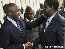 Prime Minister Raila Odinga is greeted by Laurent Gbagbo