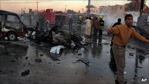 Iraqi fire fighters extinguish the fire at the site of a car bomb explosion in the Shiite district of Sadr city, in Baghdad, Iraq, Sunday, March 12, 2006