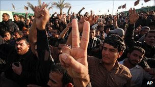 Supporters of anti-American cleric Muqtada al-Sadr gather outside his home in the Shiite city of Najaf, Iraq, Thursday, Jan. 6, 2011