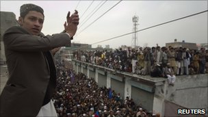Hundreds gather outside the home of Mumtaz Qadri to show their support for him in Rawalpindi on 7 January 2011