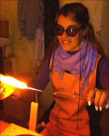 Irena at work in the glass-blowing workshop