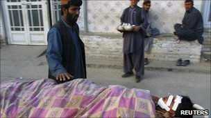 An injured man being taken away on a stretcher following a suicide bombing in Kandahar, 7 January 2010