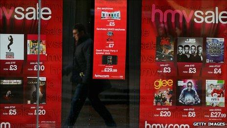 A shopper walks past an HMV store in Glasgow