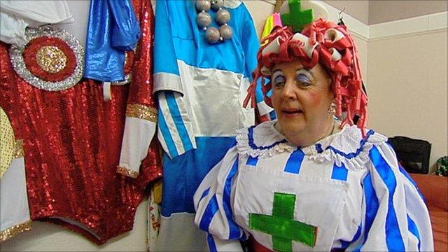 Nurse Poltis dons her new green cross