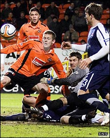 United's Scott Robertson is denied by goalkeeper Michael McGovern