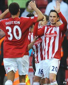 Stoke's Tuncay is congratulated after his equaliser against Cardiff