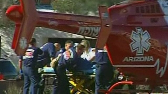 Rescue workers take victims to waiting helicopter