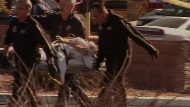 Paramedics remove shooting victim from scene