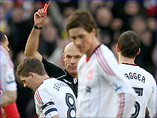liverpool skipper Steven Gerrad is shown the red card for his challenge on Michael Carrick