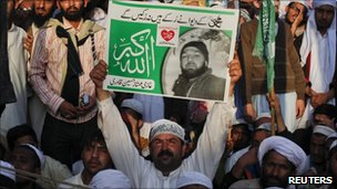 Protesters at a huge rally in Karachi on Sunday held placards supporting Qadri