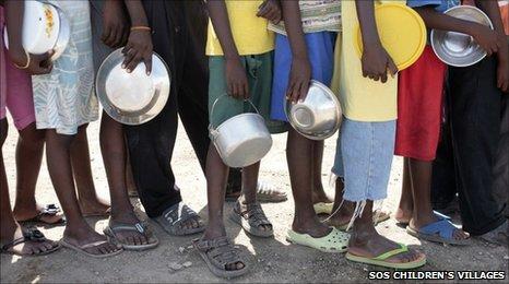 Children in Haiti queue for food