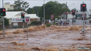 Flash floods flow through a street in Toowoomba on 10 January 2011