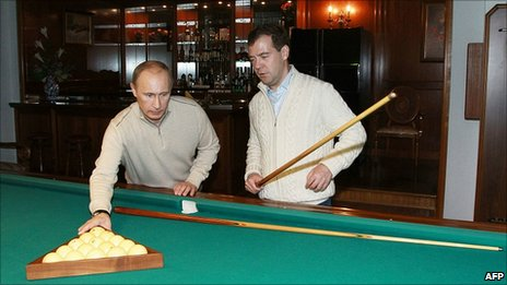 Russian President Dmitry Medvedev and Prime Minister Vladimir Putin play billiards in Sochi