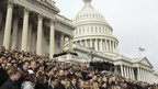 Members of Congress and staff aides gather on the steps of the US Capitol to observe a moment of silence