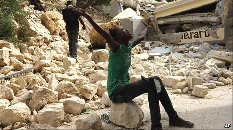 A girl screams amid the rubble of the Haiti earthquake in Port-au-Prince, 14 January, 2010
