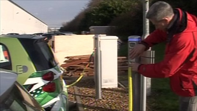 Plugging in an electric Mini to re-charge