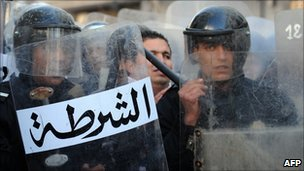Riot police stand guard in Tunisia