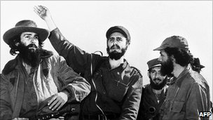 Cuban rebel leader Fidel Castro (centre), surrounded by the members of his leftist guerrilla movement &quot;26th of July Movement&quot; waves from a jeep 08 January 1959, entering La Havana 