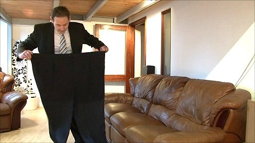 IT manager Simon Reynolds, from Nottingham, inspects his old trousers