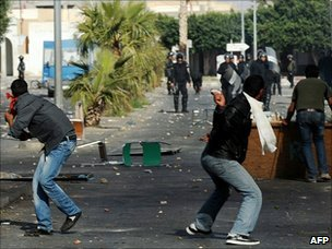 Tunisian demonstrators hurl objects towards security forces in Regueb, near Sidi Bouzid