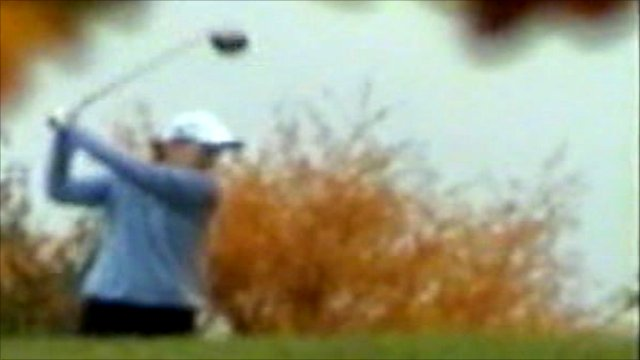 Valerie Lewis is filmed playing golf