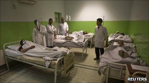 Doctors attend to wounded men at a hospital after the suicide bomb attack in Kabul