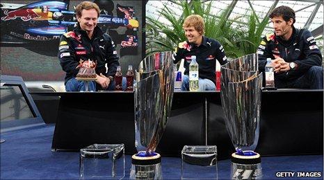 Left to right: Red Bull team chief Christian Horner, world champion Sebastian Vettel and Mark Webber
