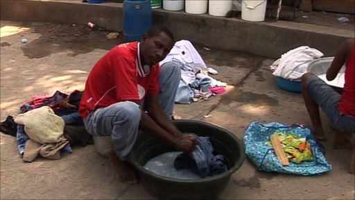 Washing clothes in a Haiti camp