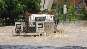 Truck driving through flood waters in Brisbane. Photo: Liam Hanlon