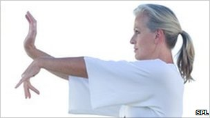 Woman practising Tai Chi