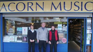 Anna Wood (left), Chris Lowe and 83 year old Mavis Slater from Acorn Records in Yeovil