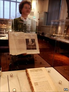 University head of heritage collections Sheila Hingley with a copy of the folio and the original in a case