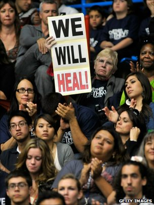 People listen to Barack Obama speaking at the McKale Memorial Center in Tucson (12 January 2011)