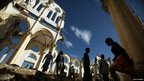 Haitians walk through Port-au-Prince's destroyed cathedral on the first anniversary of the 12 January 2010 earthquake