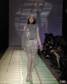 model wearing asymmetric draped silver lyocell up-cycled eco-jersey dress