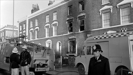 Emergency services and a policeman outside the scene of the New Cross fire in 1981