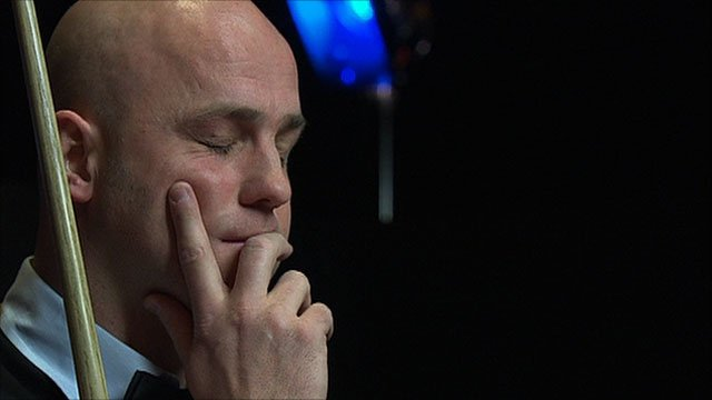 Mark King reacts to his awful shot at the Masters