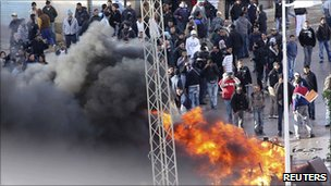 Protesters in a suburb of Tunis, 12 January 2011