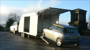 Electric mini being loaded for journey home